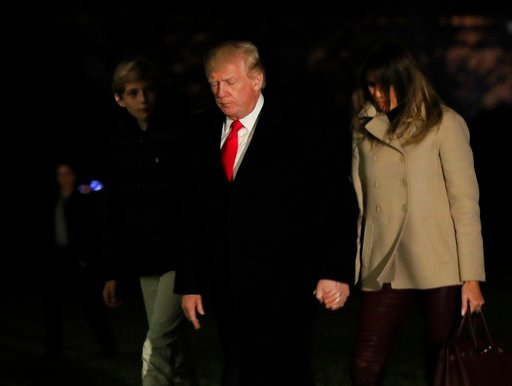 (AP Photo/Manuel Balce Ceneta). President Donald Trump together with first lady Melania Trump and their son Barron Trump returns to the White House in Washington, Monday, Jan. 1, 2018, from a holiday break at his Mar-a-Lago estate in Palm Beach, Fla.
