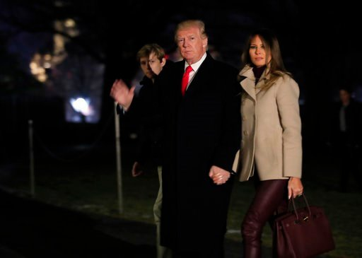 (AP Photo/Manuel Balce Ceneta). President Donald Trump together with first lady Melania Trump and their son Barron Trump waves as he returns to the White House in Washington, Monday, Jan. 1, 2018, from a holiday break at his Mar-a-Lago estate.
