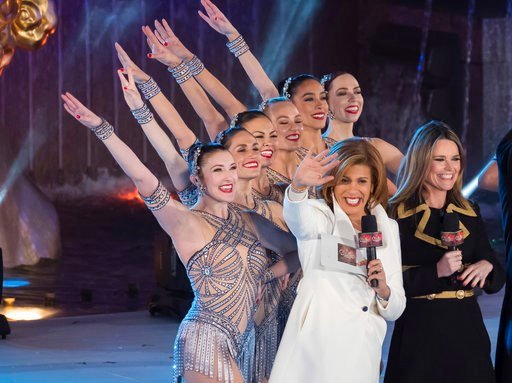 (Photo by Charles Sykes/Invision/AP, File). FILE - In this Nov. 29, 2017, file photo, Savannah Guthrie, right, and Hoda Kotb appear with the Rockettes during the 85th annual Rockefeller Center Christmas Tree lighting ceremony in New York. NBC News open...