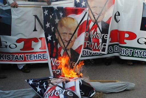 (AP Photo/Pervez Masih). Pakistani protesters burn banners showing U.S. President Donald Trump in Hyderabad, Pakistan, Tuesday, Jan. 2, 2018. Trump slammed Pakistan for 'lies & deceit' in a New Year's Day tweet that said Islamabad had played U.S. l...