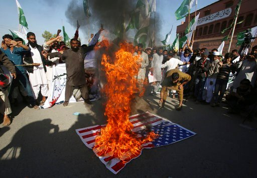 (AP Photo/Fareed Khan). Supporters of Pakistani religious groups burn a representation of an American flag at a rally to condemn a tweet by U.S. President Donald Trump, in Karachi, Pakistan, Tuesday, Jan. 2, 2018. Trump slammed Pakistan for 'lies &...