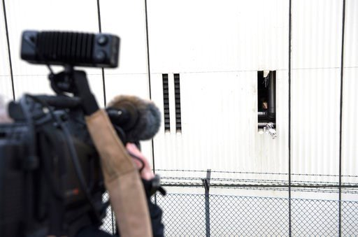 (Paul Zinken/dpa via AP, file). FILE - In this Dec. 28, 2017 file photo a cameraman films the broken ventilation slot at the workshop building on the ground of the Ploetzensee prison in Berlin, Germany, where four detainees have escaped from a local pr...