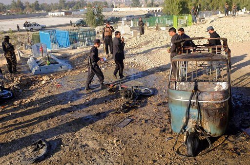 (AP Photo/Mohammad Anwar Danishyar). Afghan security forces inspect the site of a deadly bombing in Jalalabad province, east of Kabul, Afghanistan, Sunday, Dec. 31, 2017. Officials say the bombing targeted the funeral of a local official in eastern Afg...