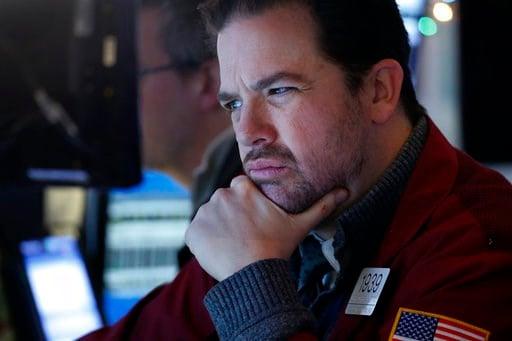(AP Photo/Mark Lennihan). Stock trader Chris Lotito studies a computer screen at the New York Stock Exchange, Tuesday, Jan. 2, 2018.