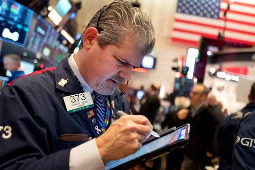 (AP Photo/Mark Lennihan). Stock trader John Panin works at the New York Stock Exchange, Tuesday, Jan. 2, 2018.