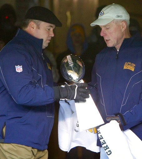"(AP Photo/Mike Roemer, File). FILE - In this Feb. 8, 2011, file photo, Green Bay Packers general manager Ted Thompson, right, hands the Vince Lombardi Trophy to coach Mike McCarthy before walking on to the field for the ""Return to Titletown"" celebratio..."