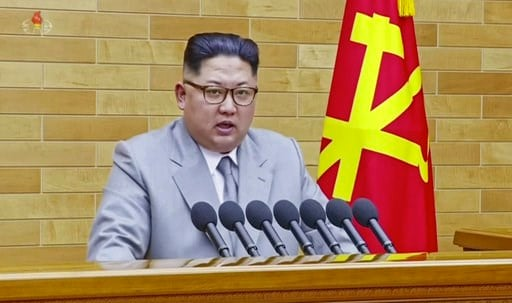 (KRT via AP Video). In this image made from video released by KRT on Jan. 1, 2018,  North Korean leader Kim Jong Un speaks in his annual address in undisclosed location, North Korea.  North Korean leader Kim said Monday, Jan. 1, 2018, the United States...