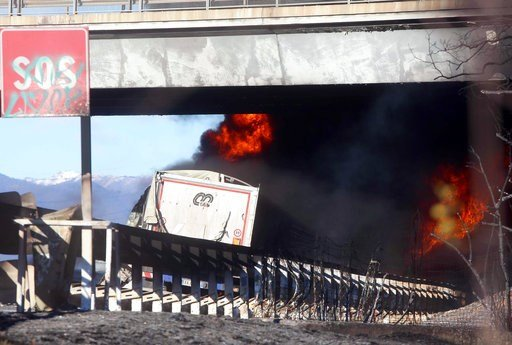 (Filippo Venezia/ANSA via AP). The back of a truck is seen as fire and black smoke engulf it after, according to reports, a tanker truck carrying inflammable liquid, which was ahead, went ablaze and caused the death of five passengers in a car and the ...