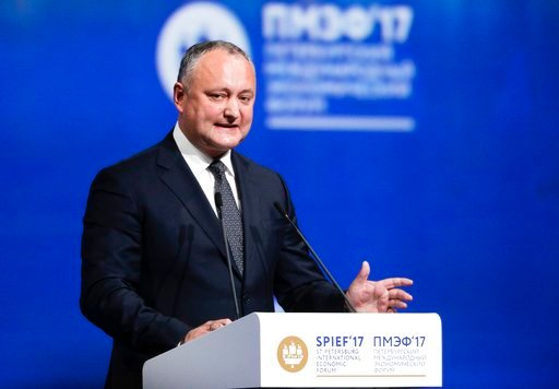 (AP Photo/Dmitry Lovetsky, File). FILE- In this Friday, June 2, 2017 file photo, Moldovan President Igor Dodon addresses the St. Petersburg International Economic Forum in St. Petersburg, Russia. Moldova's Constitutional Court has temporarily stripped ...
