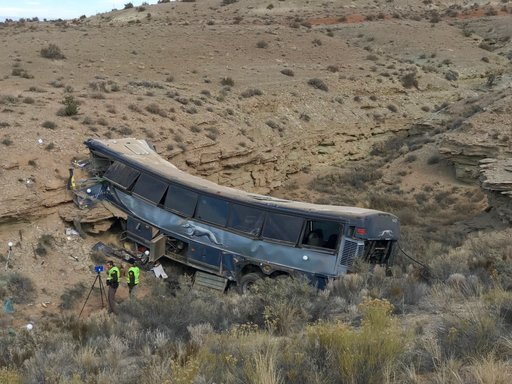 (Ben Tidswell/The Deseret News via AP). The aftermath of a late-Sunday Greyhound bus crash is seen on Monday, Jan. 1, 2018 in Emery County. A 13-year-old girl died and 11 others were hospitalized when the bus went off the freeway and crashed into a ste...
