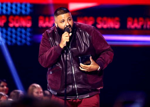 """(Photo by Matt Sayles/Invision/AP, File). FILE - In this Sunday, Nov. 19, 2017, file photo, DJ Khaled accepts the award for favorite song rap/hip-hop for """"I'm the One"""" at the American Music Awards at the Microsoft Theater in Los Angeles. Weight Watcher..."""