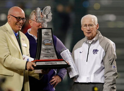 (AP Photo/Rick Scuteri). Kansas State head coach Bill Snyder, right, accepts the trophy after defeating UCLA 35-17 during an NCAA college football Cactus Bowl game, Tuesday, Dec. 26, 2017, in Phoenix.