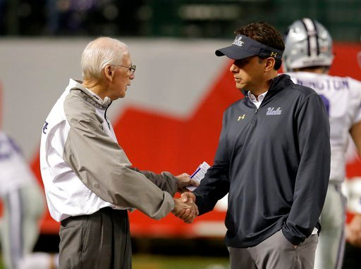 (AP Photo/Rick Scuteri). CORRECTS TO TUESDAY NOT SATURDAY Kansas State head coach Bill Snyder, left, and UCLA head coach Jedd Fisch talk before an NCAA college football bowl game, Tuesday, Dec. 26, 2017, in Phoenix.