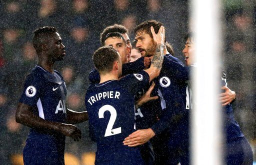 (Nigel French/PA via AP). Tottenham Hotspur's Fernando Llorente, second right, celebrates scoring his side's first goal of the game against Swansea, during their English Premier League soccer match at the Liberty Stadium in Swansea, England, Tuesday Ja...