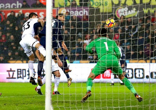 (Nigel French/PA via AP). Tottenham Hotspur's Fernando Llorente, second right, scores his side's first goal of the game against Swansea, during their English Premier League soccer match at the Liberty Stadium in Swansea, England, Tuesday Jan. 2, 2018.