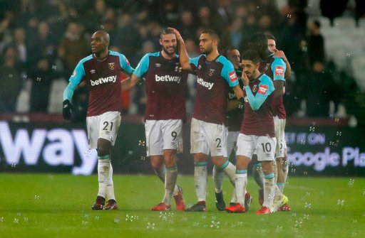 (AP Photo/Frank Augstein). West Ham's Andy Carroll, second from left, celebrates with teammates after scoring his side's second goal during the English Premier League soccer match between West Ham and West Bromwich Albion at London Stadium in London, T...