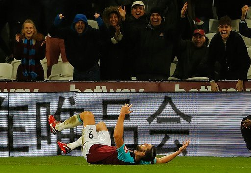 (AP Photo/Frank Augstein). West Ham's Andy Carroll celebrates after scoring his side's second goal during the English Premier League soccer match between West Ham and West Bromwich Albion at London Stadium in London, Tuesday, Jan. 2, 2018.