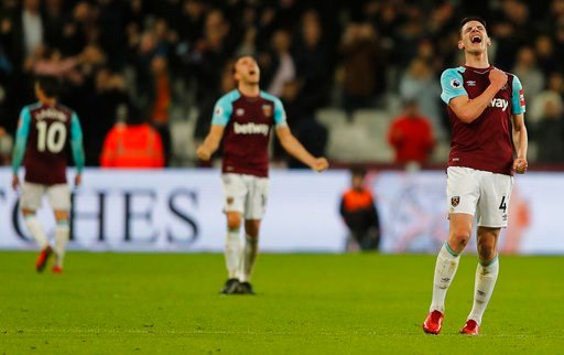 (AP Photo/Frank Augstein). West Ham players celebrate after Andy Carroll scored his side's second goal during the English Premier League soccer match between West Ham and West Bromwich Albion at London Stadium in London, Tuesday, Jan. 2, 2018.