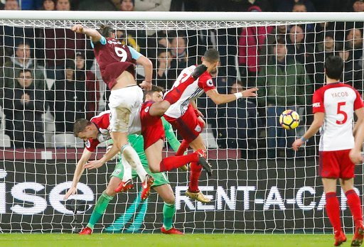 (AP Photo/Frank Augstein). West Ham's Andy Carroll, left, heads the ball to score during the English Premier League soccer match between West Ham and West Bromwich Albion at London Stadium in London, Tuesday, Jan. 2, 2018.
