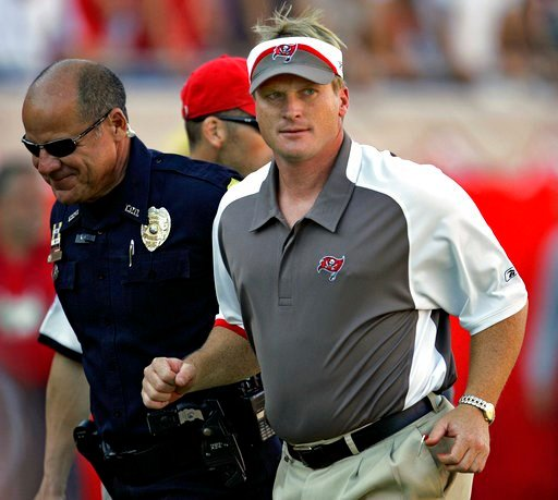 (AP Photo/Chris O'Meara, File). FILE - In this Sunday Nov. 4, 2007 file photo, Tampa Bay Buccaneers head coach Jon Gruden, right, leaves the field after an NFL football game against the Arizona Cardinals  in Tampa, Fla. Jon Gruden says he hopes he's a ...