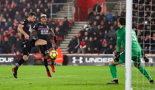 (Andrew Matthews/PA via AP). Crystal Palace's James McArthur, left, scores his side's first goal of the game against Southampton during their English Premier League soccer match at St Mary's Stadium in Southampton, Tuesday Jan. 2, 2018.