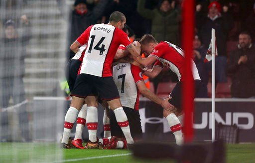 (Andrew Matthews/PA via AP). Southampton's Shane Long, centre, celebrates scoring his side's first goal of the game with team-mates during the English Premier League soccer match against Crystal Palace at St Mary's Stadium, Southampton, England, Tuesda...