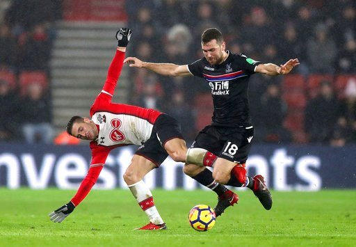 (Andrew Matthews/PA via AP). Southampton's Dusan Tadic, left, and Crystal Palace's James McArthur in action during their English Premier League soccer match at St Mary's Stadium in Southampton, England, Tuesday Jan. 2, 2018.