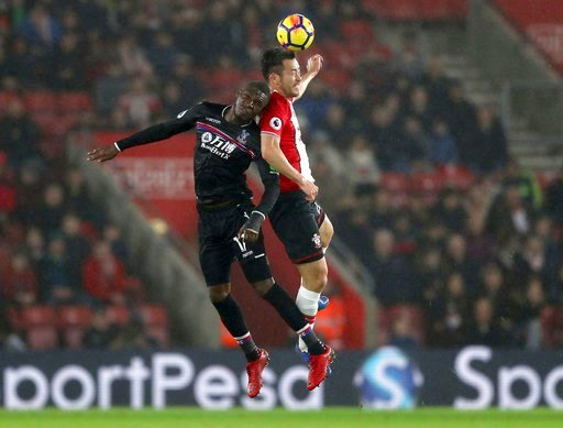 (Andrew Matthews/PA via AP). Crystal Palace's Christian Benteke, left, and Southampton's Maya Yoshida battle for the ball during the English Premier League soccer match at St Mary's Stadium, Southampton, England, Tuesday, Jan. 2, 2018.
