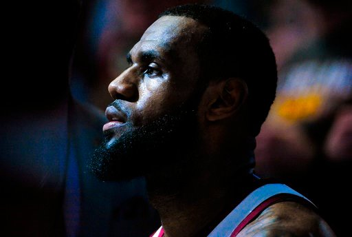 (AP Photo/Alex Goodlett). Cleveland Cavaliers forward LeBron James (23) waits during a timeout in the second half of an NBA basketball game against the Utah Jazz on Saturday, Dec. 30, 2017, in Salt Lake City.