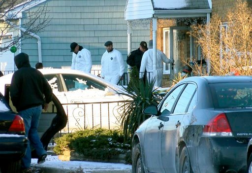 (Thomas P. Costell/The Asbury Park Press via AP). Authorities investigate outside a home in Long Branch, N.J., Monday, Jan. 1, 2018. A 16-year-old has been arrested after his parents, sister and a family friend were found dead inside the home where the...