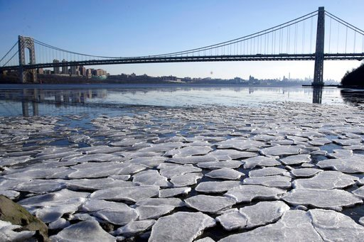 (AP Photo/Julio Cortez). A layer of ice is broken into pieces floating along the banks of the Hudson River at the Palisades Interstate Park with the George Washington Bridge in the background, Tuesday, Jan. 2, 2018, in Fort Lee, N.J. The Northern New J...