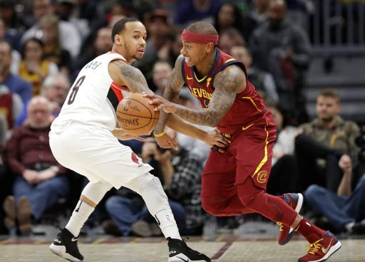 (AP Photo/Tony Dejak). Cleveland Cavaliers' Isaiah Thomas, right, drives past Portland Trail Blazers' Al-Farouq Aminu in the first half of an NBA basketball game, Tuesday, Jan. 2, 2018, in Cleveland.