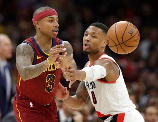 (AP Photo/Tony Dejak). Cleveland Cavaliers' Isaiah Thomas (3) passes against Portland Trail Blazers' Damian Lillard (0) in the first half of an NBA basketball game, Tuesday, Jan. 2, 2018, in Cleveland.