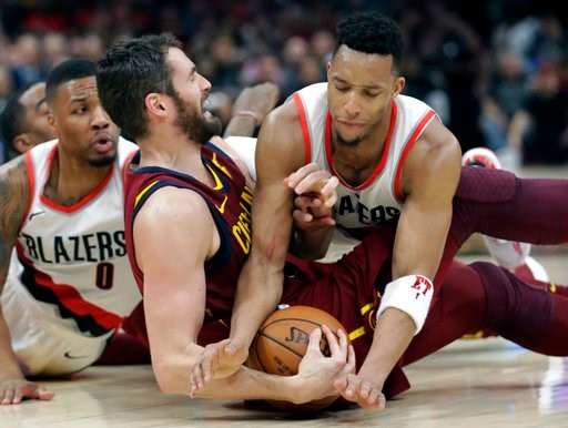 (AP Photo/Tony Dejak). Portland Trail Blazers' Evan Turner, right, tries to get the ball loose from Cleveland Cavaliers' Kevin Love in the first half of an NBA basketball game, Tuesday, Jan. 2, 2018, in Cleveland.