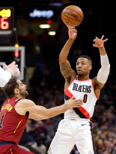 (AP Photo/Tony Dejak). Portland Trail Blazers' Damian Lillard (0) passes over Cleveland Cavaliers' Jose Calderon (81), from Spain, in the first half of an NBA basketball game, Tuesday, Jan. 2, 2018, in Cleveland.
