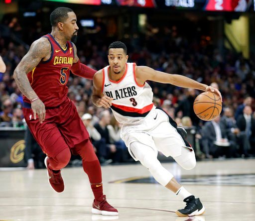 (AP Photo/Tony Dejak). Portland Trail Blazers' CJ McCollum (3) drivers past Cleveland Cavaliers' JR Smith (5) in the first half of an NBA basketball game, Tuesday, Jan. 2, 2018, in Cleveland.