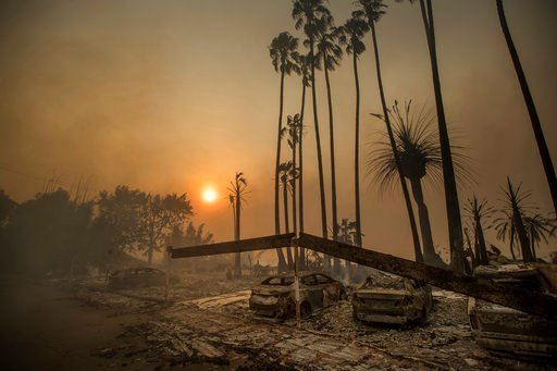 (AP Photo/Noah Berger, File). In this Dec. 5, 2017, file photo, Smoke rises behind a leveled apartment complex as a wildfire burns in Ventura, Calif. Over 100 structures have burned so far in Ventura County, officials said.