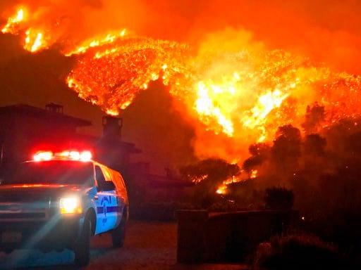 (Mike Eliason/Santa Barbara County Fire Department via AP, File). In this Dec. 12, 2017, file photo provided by the Santa Barbara County Fire Department, fire burns canyons and ridges above Bella Vista Drive near Romero Canyon.