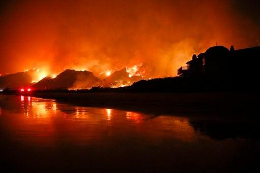 (AP Photo/Jae C. Hong, File). In this Dec. 5, 2017, file photo, a wildfire burns along the 101 Freeway in Ventura, Calif.