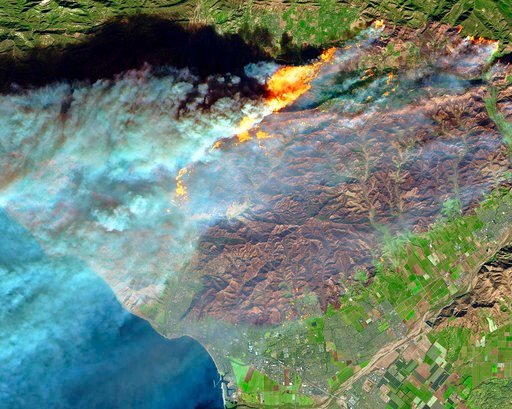 (European Space Agency/NASA via AP, File). This Dec. 7, 2017, false-color image from the European Space Agency's Sentinel-2 satellite via NASA, shows a brown burn scar from the Thomas fire north of the city of Ventura, Calif., at bottom center.