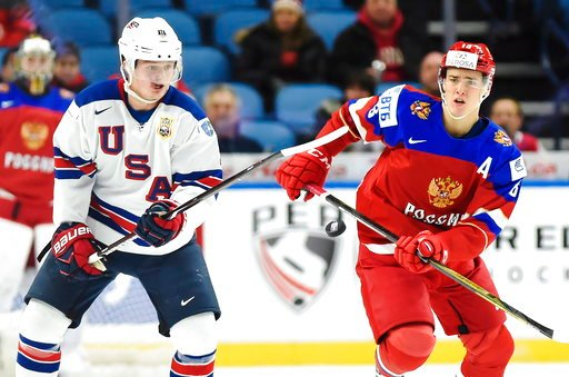 (Nathan Denette/The Canadian Press via AP). United States forward Casey Mittelstadt (11) and Russia forward Mikhail Maltsev (13) vie for the puck during the first period of a quarterfinal in the IIHF world junior hockey championships in Buffalo, N.Y., ...
