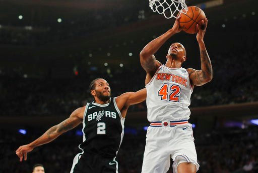 (AP Photo/Julie Jacobson). New York Knicks forward Lance Thomas (42) puts up a shot against San Antonio Spurs forward Kawhi Leonard (2) during the second quarter of an NBA basketball game, Tuesday, Jan. 2, 2018, in New York.