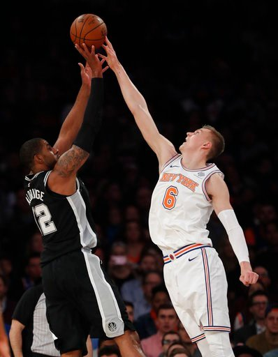 (AP Photo/Julie Jacobson). New York Knicks forward Kristaps Porzingis (6) blocks a shot by San Antonio Spurs forward LaMarcus Aldridge (12) during the first quarter of an NBA basketball game, Tuesday, Jan. 2, 2018, in New York.