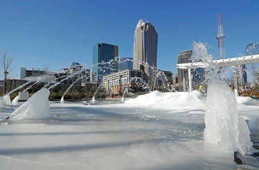(AP Photo/Chuck Burton). Water squirts from a frozen fountain near downtown in Charlotte, N.C., Tuesday, Jan. 2, 2018.