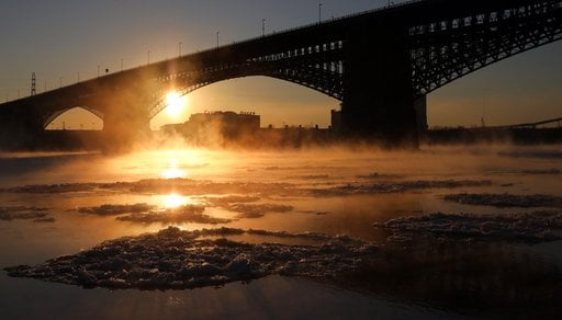 (Laurie Skrivan/St. Louis Post-Dispatch via AP). Steam rises above the waters of the Mississippi River underneath the Eads Bridge as the temperature hovers around -1 degrees Fahrenheit on Tuesday, Jan. 2, 2018, in St. Louis.