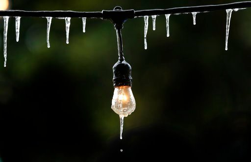 ( Steve Gonzales/Houston Chronicle via AP). Icicles form on a outdoor string of lights as temperatures struggle to get above freezing Tuesday, Jan. 2, 2018, in Houston.