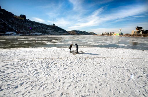 (Steve Mellon/Post-Gazette via AP). Samantha Ritter of Robinson gave Matthew Sun his first glimpse of Pittsburgh's Point, which was snow-covered and frozen on Tuesday, Jan. 2, 2018.