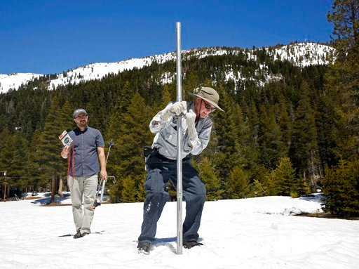(AP Photo/Rich Pedroncelli, File). File - In this May 1, 2017 file photo, Frank Gehrke, chief of the California Cooperative Snow Surveys Program for the Department of Water Resources, right, plunges the snow survey tube into the snow pack, as DWR's Wes...