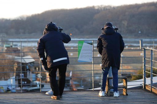 (AP Photo/Lee Jin-man). Visitors use binoculars to see the North side from the Imjingak Pavilion in Paju, South Korea, Wednesday, Jan. 3, 2018. North Korean leader Kim Jong Un reopened a key cross-border communication channel with South Korea for the f...