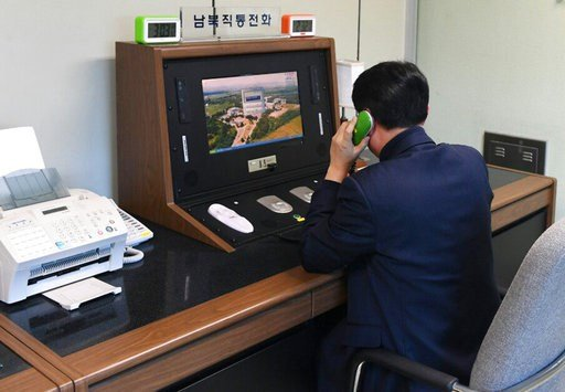 (Yonhap via AP). A South Korean government official checks the direct communications hotline to talk with the North Korean side at the border village of Panmunjom in Paju, South Korea, Wednesday, Jan. 3, 2018. North Korean leader Kim Jong Un reopened a...
